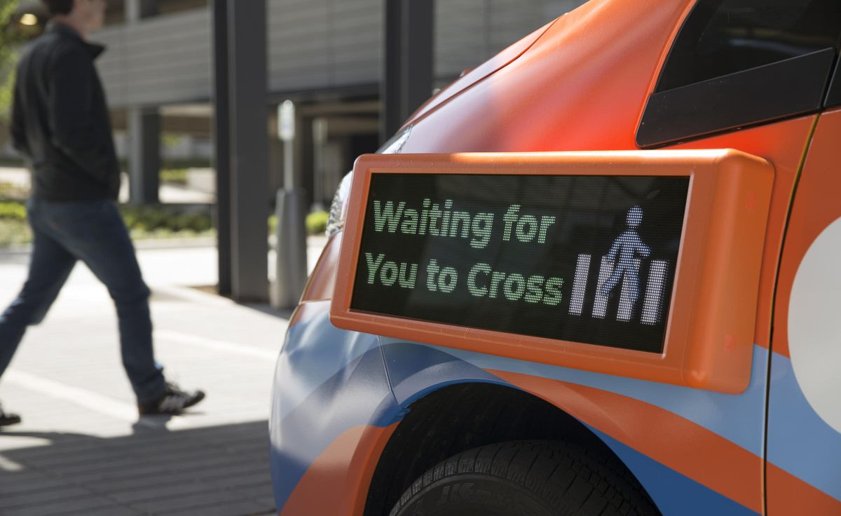 """LED screen that reads """"waiting for you to cross"""""""