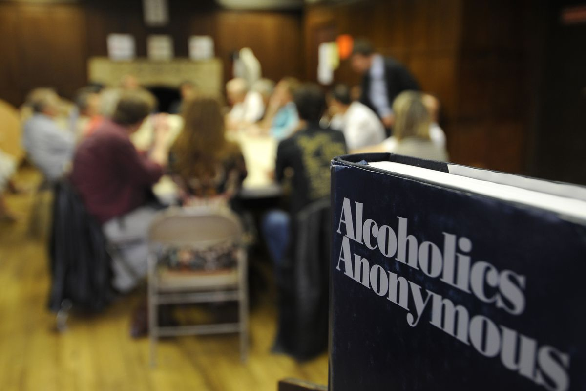 People gather at an Alcoholics Anonymous meeting at the American Church in Paris.