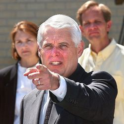 Salt Lake City Police Chief Rick Dinse points for the next question at a press conference on Monday June 24, 2002, as he and family members of Elizabeth Smart update the Media on the case. Ed and Lois Smart stand in the background.