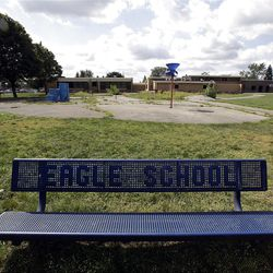 A bench is shown outside the former Eagle Elementary School in West Bloomfield, Mich.