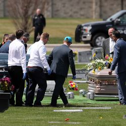 Family members of Tony and Katherine Butterfield gather in the Herriman City Cemetery for graveside services on Saturday, April 25, 2020. The couple was shot and killed at their home in West Jordan on Saturday, April 18, 2020. Albert Enoch Johnson was arrested the following Wednesday in Stockton, California, in connection with the Butterfields' deaths.