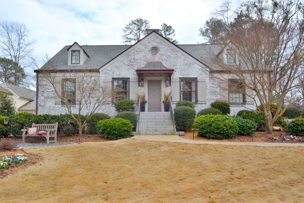 A new listing in Buckhead, a white-brick house from the 1930s.