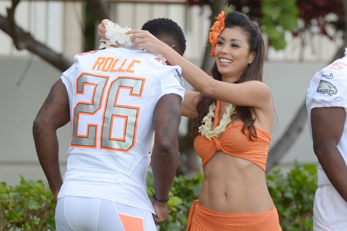 Antrel Rolle is presented with a lei during Pro Bowl Media Day festivities