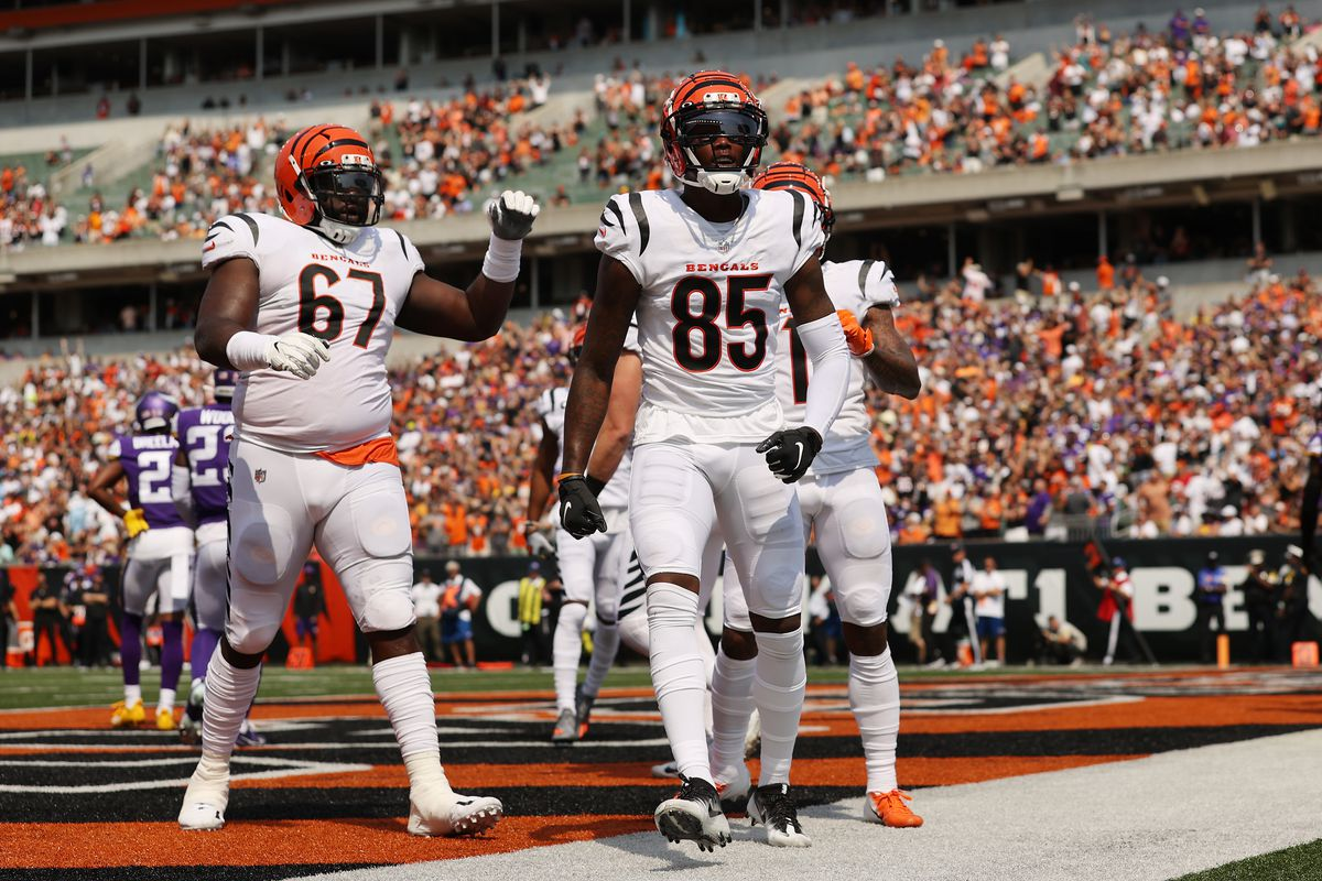 Tee Higgins #85 of the Cincinnati Bengals celebrates after catching a 2-yard touchdown pass from Joe Burrow #9 (not pictured) during the second quarter against the Minnesota Vikings at Paul Brown Stadium on September 12, 2021 in Cincinnati, Ohio.