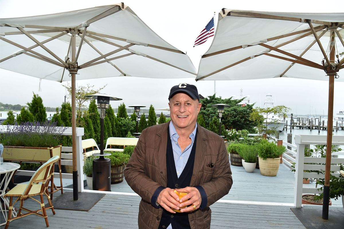 Ron Perelman wears a brown jacket and a black hat.