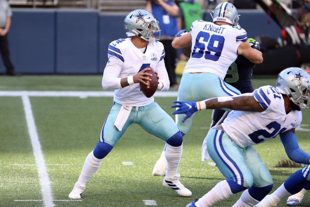 Dak Prescott #4 of the Dallas Cowboys looks to throw the ball in the fourth quarter against the Seattle Seahawks at CenturyLink Field on September 27, 2020 in Seattle, Washington.