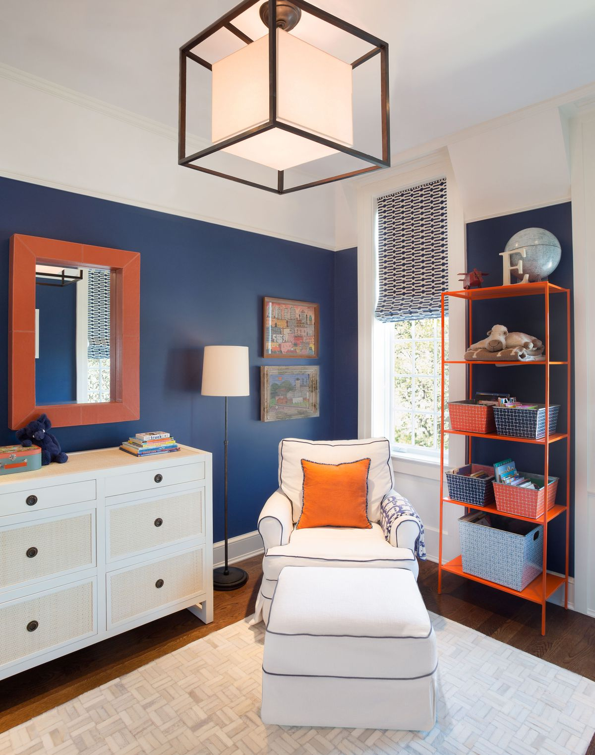 Room with blue wall and orange accents.
