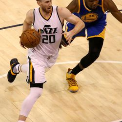 Utah Jazz forward Gordon Hayward (20) dribbles around Golden State Warriors forward Kevin Durant (35) during Game 4 of the second round of NBA playoffs at Vivint Smart Home Arena in Salt Lake City on Monday, May 8, 2017.