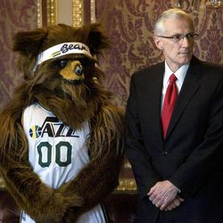 The Jazz Bear and Utah Lt. Governor Greg Bell watch as the governor signs  proclamations honoring retired Utah Jazz coaches Jerry Sloan and Phil Johnson at the Capitol on March 7, 2011.