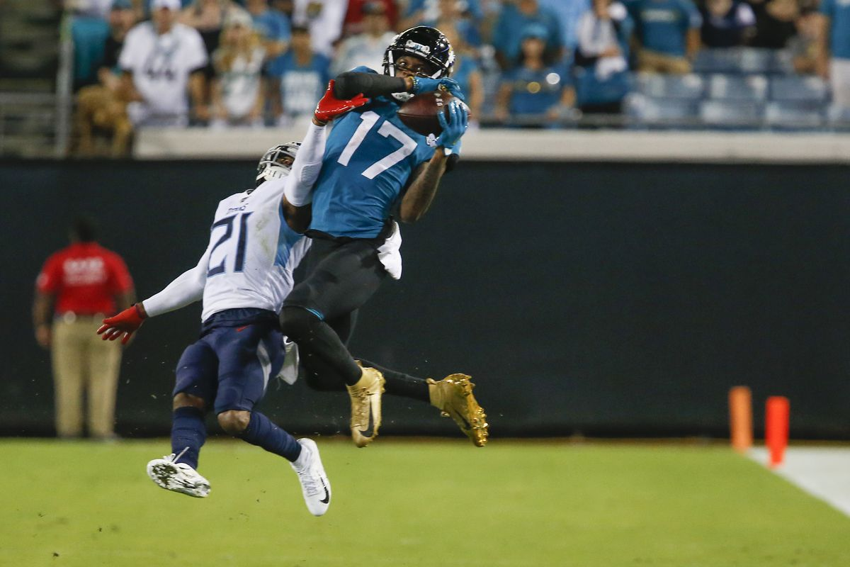 Tennessee Titans cornerback Malcolm Butler guards against the catch by Jacksonville Jaguars wide receiver D.J. Chark during the second half at TIAA Bank Field.