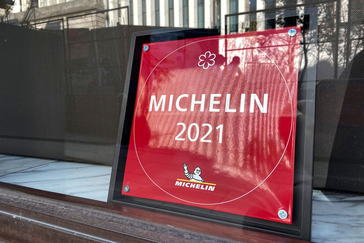 A Michelin 2021 sign sits behind a shop window