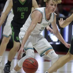 Farmington's Collin Chandler dribbles the ball in front of Provo's Taylor Heiner during the 5A boys basketball state quarterfinals at the Huntsman Center in Salt Lake City on Tuesday, Feb. 25, 2020. Farmington won 78-76 in overtime.