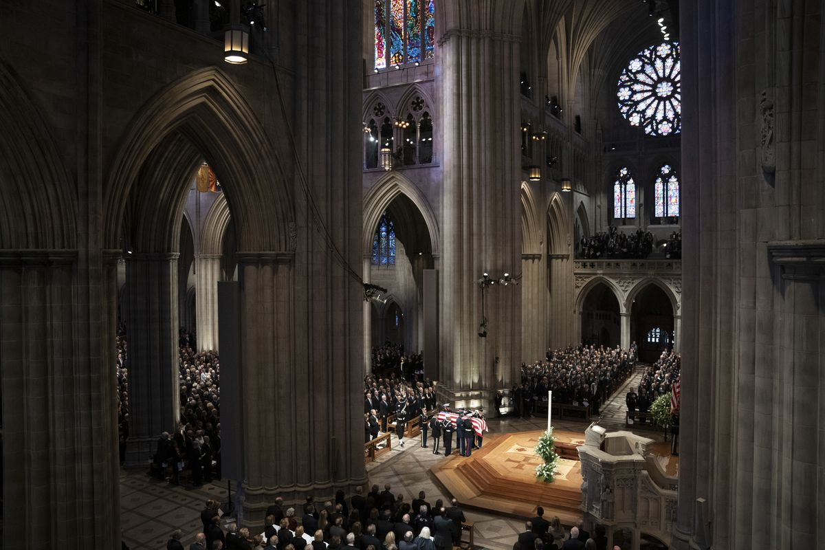 December 5: The flag-draped casket of former President George H.W. Bush is carried by a military honor guard during his State Funeral Service at Washington National Cathedral in Washington. (Carolyn Kaster/AP)