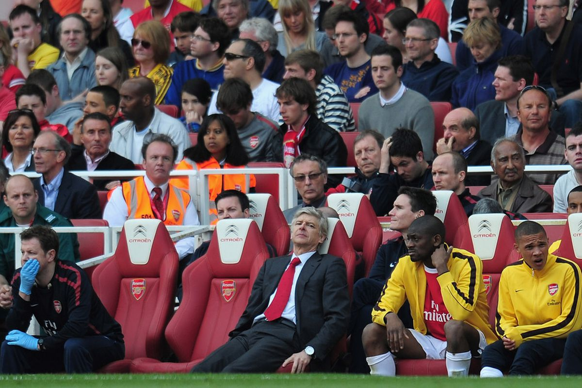 LONDON, ENGLAND - APRIL 17:  Arsenal manager Arsene Wenger looks dejected during the Barclays Premier League match between Arsenal and Liverpool at the Emirates Stadium on April 17, 2011 in London, England.  (Photo by Shaun Botterill/Getty Images)
