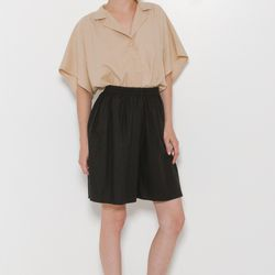 Raw silk dresses up an elastic waist short that are as comfortable pajamas.