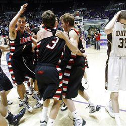 Davis' #32 Riley Watts (right) walks off the floor as Alta players celebrate their win 46-32 in the 5A boys Basketball championship game in Ogden.  Saturday, March 6, 2010. Photo by Scott G Winterton Deseret News.