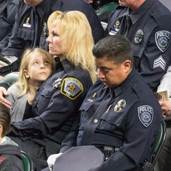 Law enforcement officers and the families attend funeral services for Unified police officer Doug Barney at the Maverik Center in West Valley City on Monday, Jan. 25, 2016.