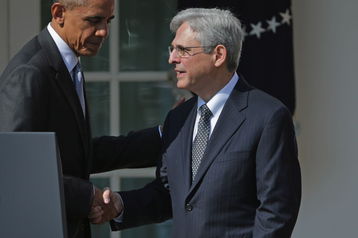 President Barack Obama (L) shakes hands with Judge Merrick Garland, the president's nominee to replace the late Supreme Court Justice Antonin Scalia, in the Rose Garden at the White House, March 16, 2016, in Washington, DC.
