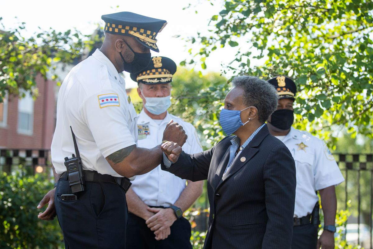 Chicago Mayor Lori Lightfoot greets police officers before a press conference at the 10th District Police Station in Lawndale Thursday morning, Aug. 20, 2020.