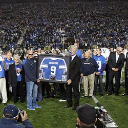 Former BYU player Jim McMahon is honored at Brigham Young University in Provo, Friday, Oct. 3, 2014.