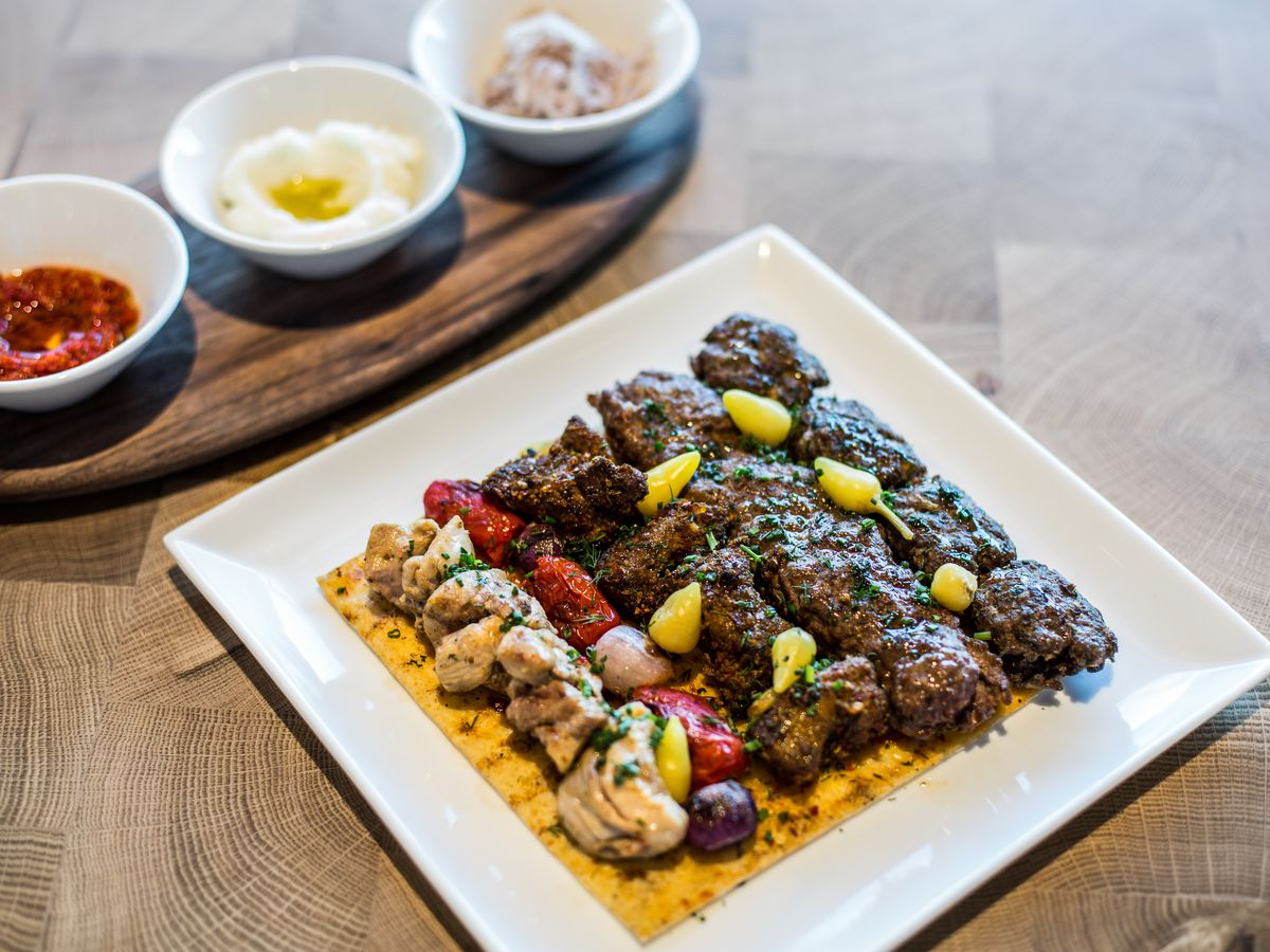 A platter of lamb and chicken skewers