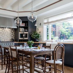 """A long farm table with informal seating sits in the middle of the kitchen, perfect for food prep or homework. [Photo by <a href=""""http://www.patriciachangphotography.com/"""">Patricia Chang</a>]"""