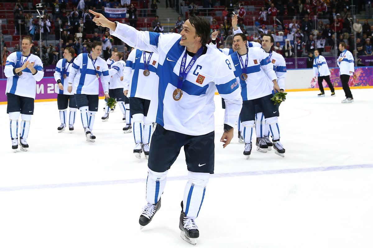 Teemu Selanne and team Finland take a victory lap after defeating the US in the bronze medal game.