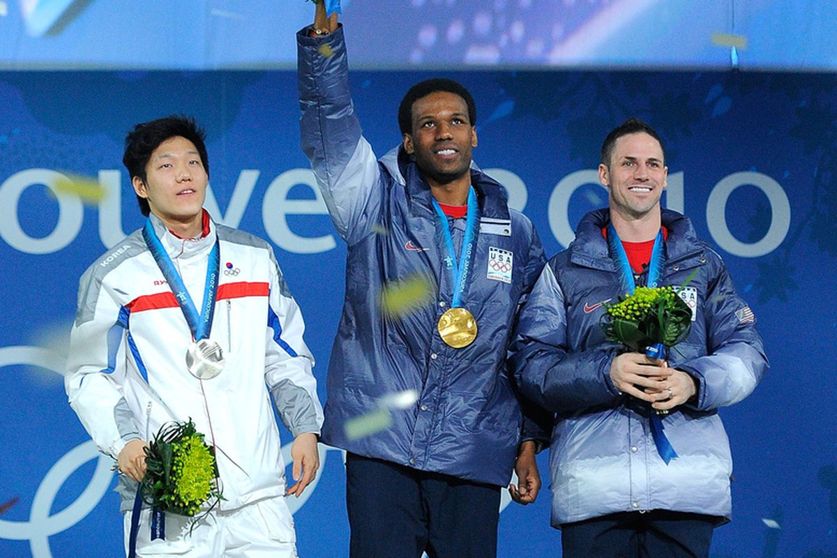 Tae-Bum Mo of South Korea celebrates winning Silver, Shani Davis of United States Gold, and Chad Hedrick of United States Bronze during the medal ceremony for the Mens 1000m Speed Skating on day 7 of the Vancouver 2010 Winter Olympics.