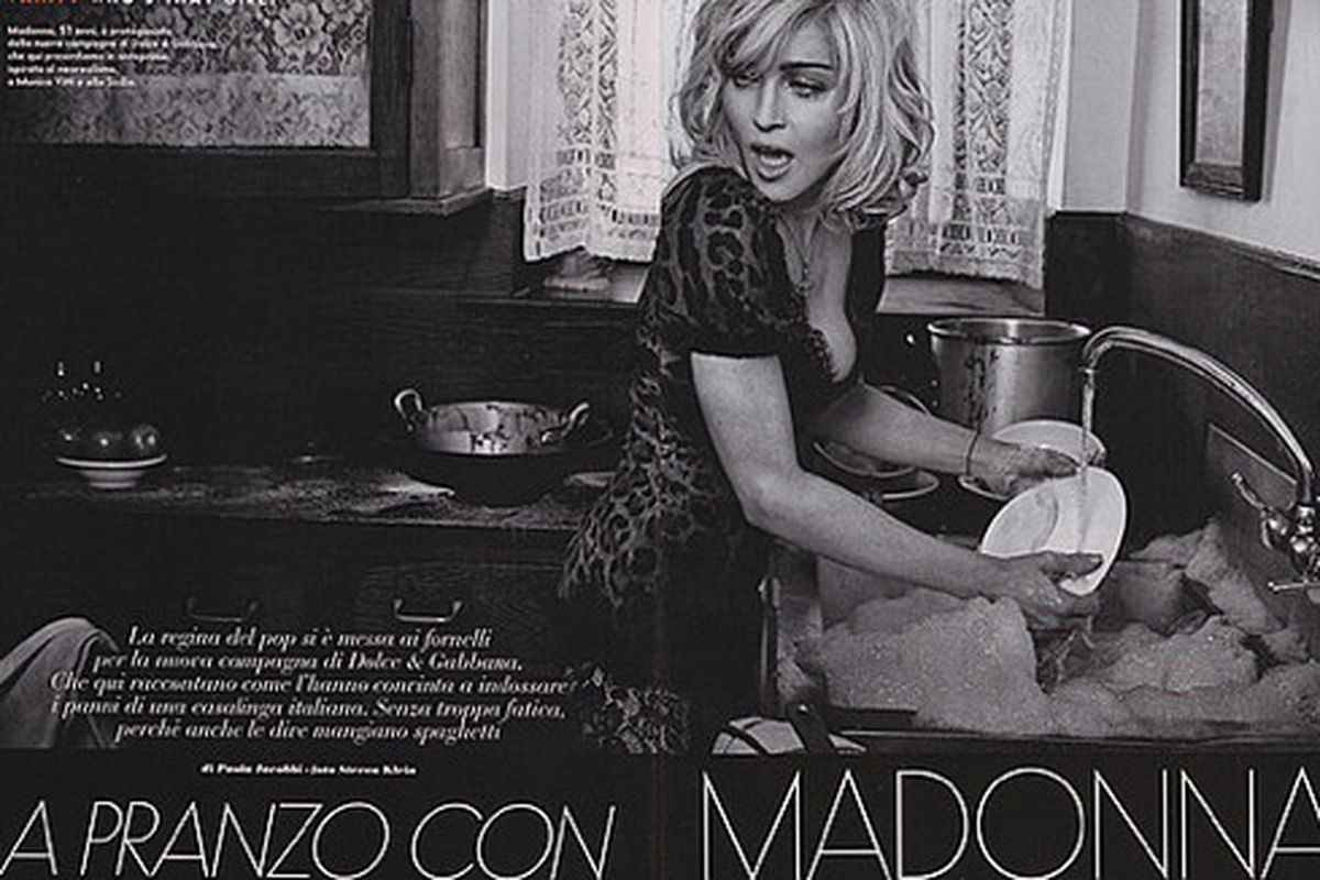 """We laughed so hard at the thought of Madonna doing dishes that tears ran down our faces. Image via <a href=""""http://www.fashionologie.com/6679814"""">Fashionologie</a>."""
