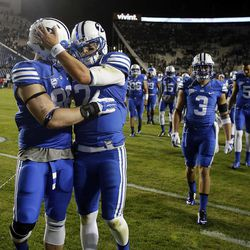 Tanner Balderree (98) and Christian Stewart (7) of the Brigham Young University Cougars walk off the field after losing to USU in NCAA football in Provo, Friday, Oct. 3, 2014.