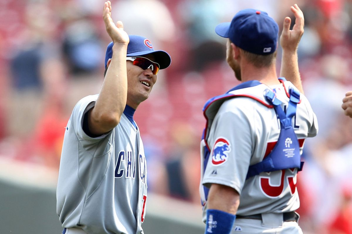 Kosuke Fukudome of the Chicago Cubs celebrates with Koyie Hill after the final out of the game against the Cincinnati Reds at Great American Ball Park on June 8, 2011 in Cincinnati, Ohio. The Cubs won 4-1.  (Photo by Andy Lyons/Getty Images)