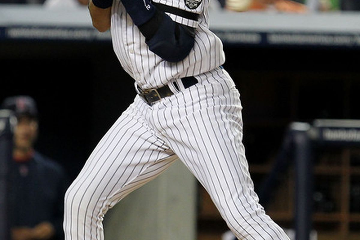 NEW YORK - AUGUST 06:  Derek Jeter #2 of the New York Yankees is hit with a pitch by Clay Bucholz of the Boston Red Sox on August 6 2010 at Yankee Stadium in the Bronx borough of New York City.  (Photo by Al Bello/Getty Images)