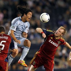 KANSAS CITY, KS - APRIL 14:  Roger Espinoza #15 of Sporting Kansas City battles Nat Borchers #6 of Real Salt Lake for the ball during the Major League Soccer game on April 14, 2012 at Livestrong Sporting Park in Kansas City, Kansas.  (Photo by Jamie Squire/Getty Images)