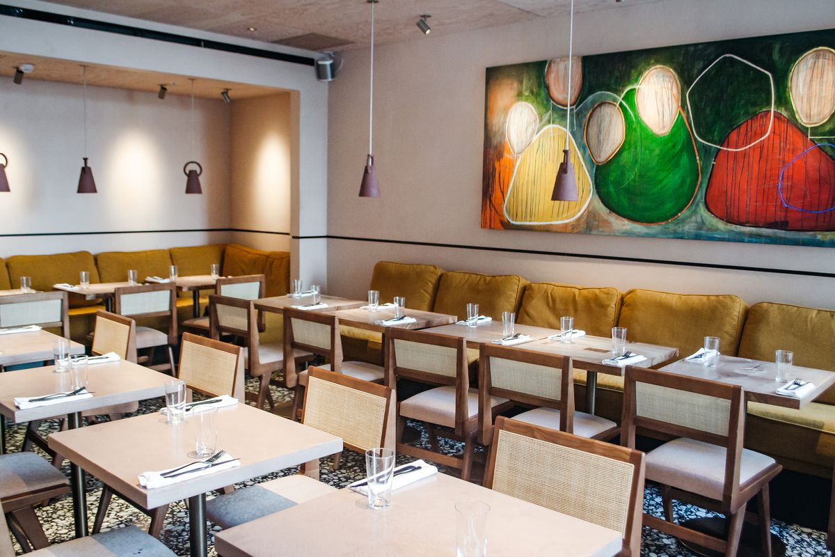 Hanging lights and table settings at west African restaurant Ikoyi, in London