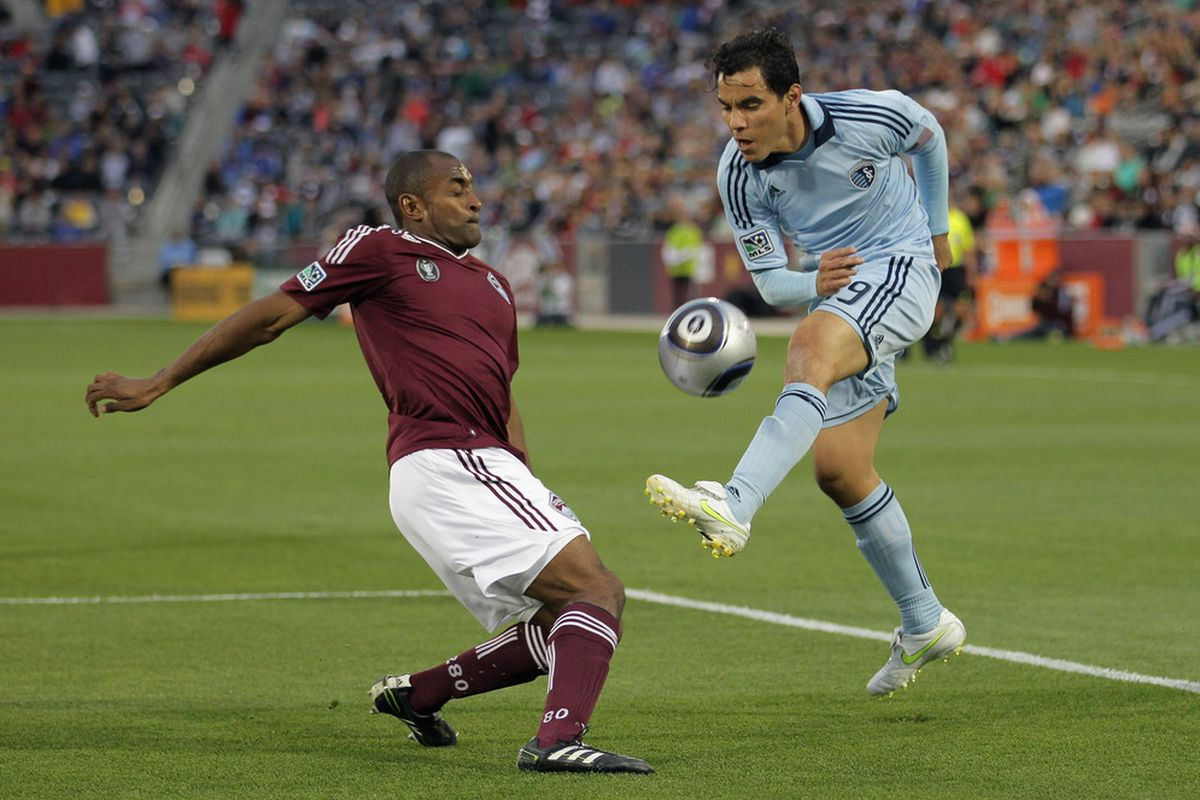 COMMERCE CITY, CO - MAY 28:  Omar Bravo #99 of Sporting KC has a shot blocked by Marvell Wynne #22 of the Colorado Rapids at Dick's Sporting Goods Park on May 28, 2011 in Commerce City, Colorado.  (Photo by Doug Pensinger/Getty Images)