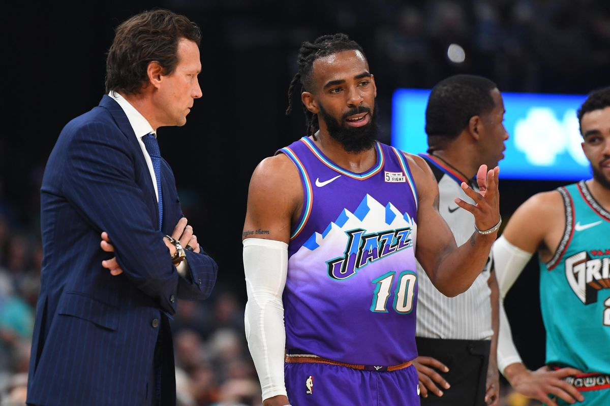 Utah Jazz guard Mike Conley talks with Utah Jazz head coach Quin Snyder during the first half against the Memphis Grizzlies at FedExForum.