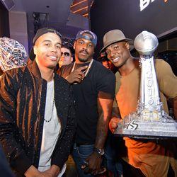 Malik Jackson, Kenny Anunike and DeMarcus Ware at XS. Photo: Karl Larson