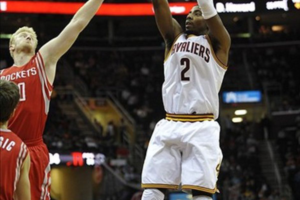 Feb 28, 2012; Cleveland, OH, USA; Cleveland Cavaliers point guard Kyrie Irving (2) shoots in the fourth quarter against the Houston Rockets at Quicken Loans Arena. Mandatory Credit: David Richard-US PRESSWIRE