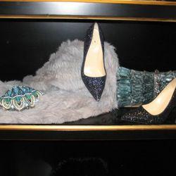 Judith Leiber clam shell, $4,995<br />Kate Spade glitter Licorice pumps, $350<br />Judith Leiber python ruffle clutch, $3,995