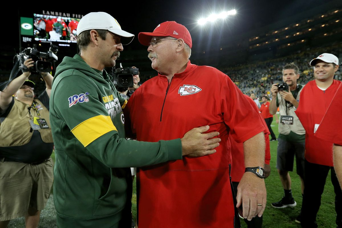 Aaron Rodgers of the Green Bay Packers and head coach Andy Reid of the Kansas City Chiefs meet after the Packers beat the Chiefs 27-20 in a preseason game at Lambeau Field on August 29, 2019 in Green Bay, Wisconsin.