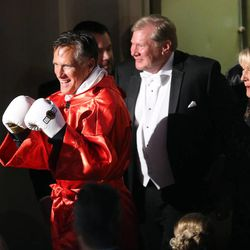Former Massachusetts Gov. Mitt Romney walks to the ring to fight five-time heavyweight champion Evander Holyfield at Charity Vision Fight Night at The Rail Event Center in Salt Lake City on Friday, May 15, 2015.