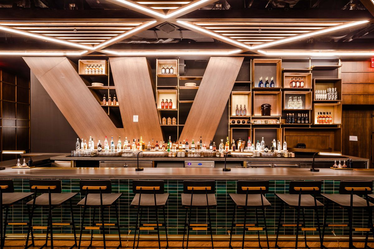 The light brown bar at Kawi appears lit and ready for service