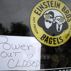 A sign announces the closing of an Einstein Bros. Bagels store due to power outage in Plano, Texas, Wednesday, Feb. 2, 2011. The cold has forced rolling blackouts across Texas.