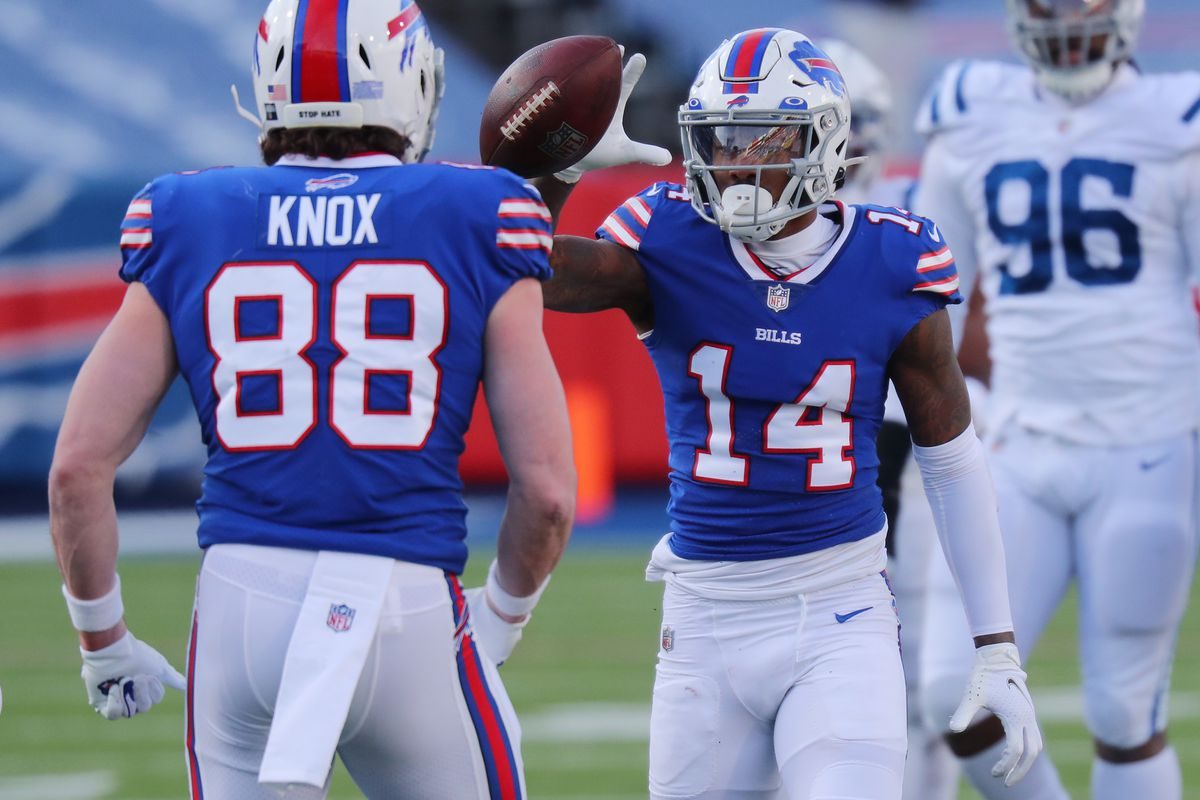 Stefon Diggs #14 reacts with Dawson Knox #88 of the Buffalo Bills after making a first-down reception during the second half of the AFC Wild Card playoff game against the Indianapolis Colts at Bills Stadium on January 09, 2021 in Orchard Park, New York.
