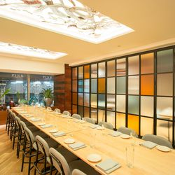 The walls open and close to create a private dining room.