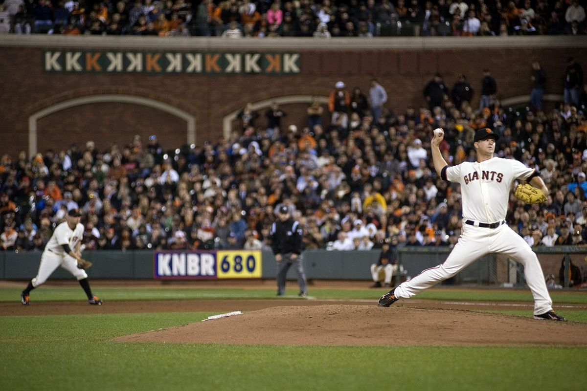 June 13, 2012; San Francisco, CA, USA; San Francisco Giants starting pitcher Matt Cain (right) pitches during the eighth inning against the Houston Astros at AT&T Park.  Mandatory Credit: Ed Szczepanski-US PRESSWIRE
