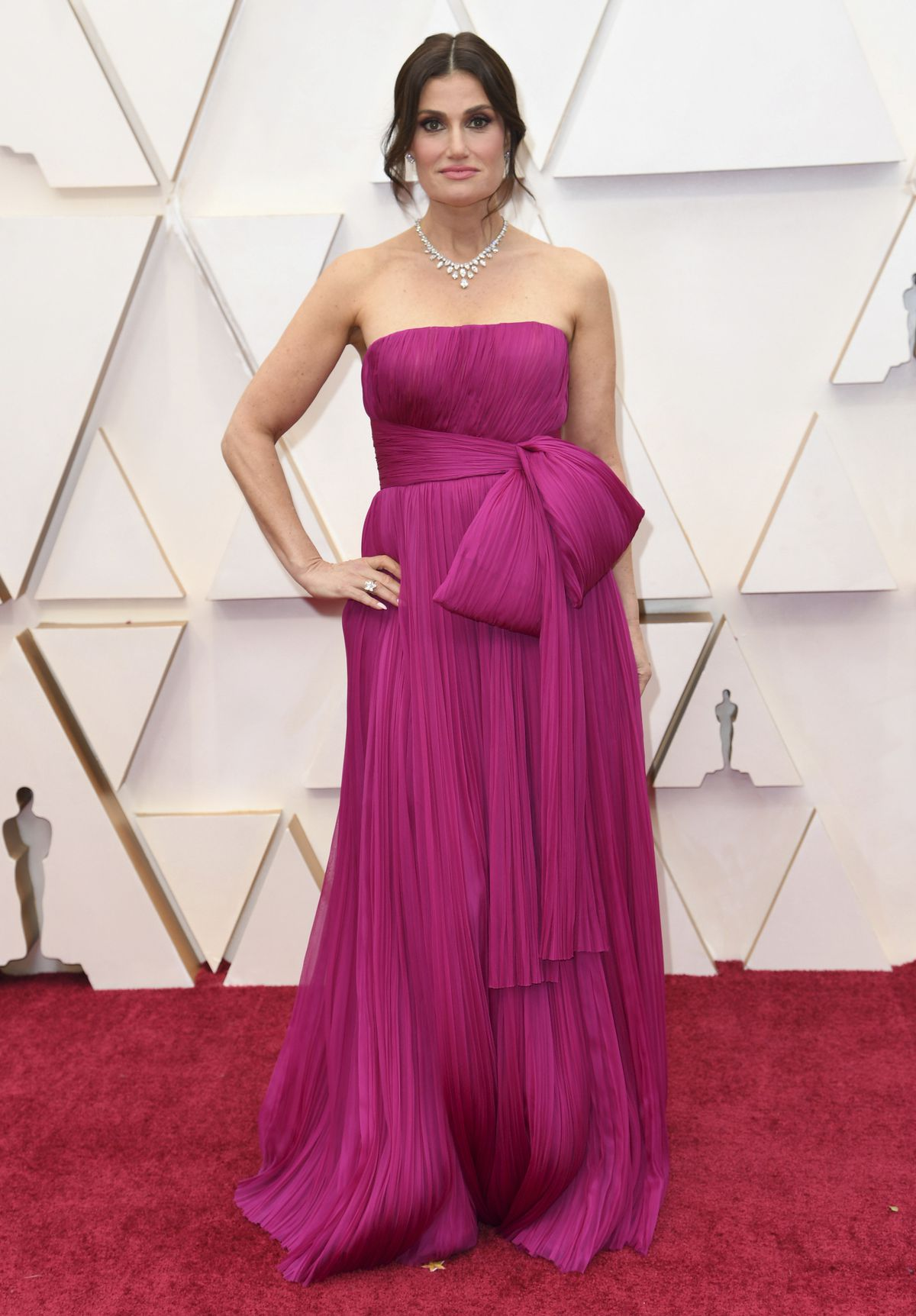 Idina Menzel, wearing a magenta J Mendel gown, arrives at the Oscars on Sunday at the Dolby Theatre in Los Angeles.