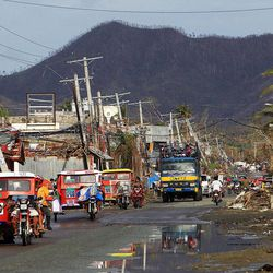 Vehicles travel in Tacloban, Friday, Nov. 22, 2013.