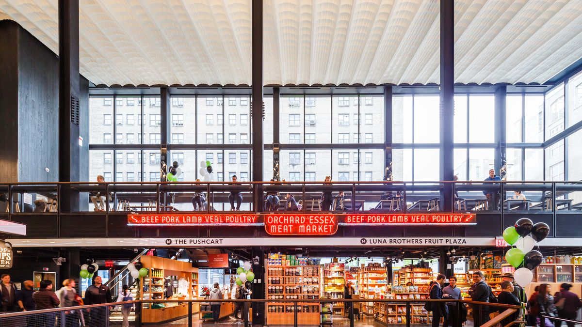 A huge food hall with floor-to-ceiling windows and a top floor of dining area