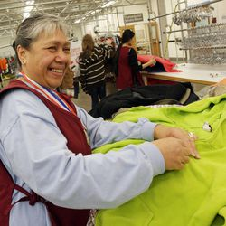 Associate Lima Taloa laughs with colleagues as she sorts clothing at Deseret Industries at the LDS Church's  Welfare Square in Salt Lake City  Thursday, April 7, 2011.  Taloa is in training to upgrade his skills to be employed elsewhere in the community.